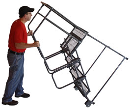 Photo of worker rolling a 4-step ladder